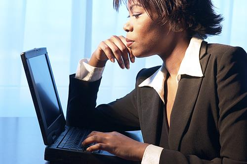 Image of woman looking at computer